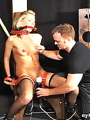 The new slave girl obeys Master Scott and strips down to her fishnet thigh highs