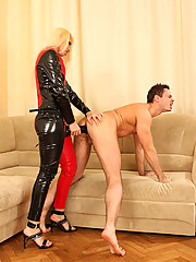 Dominatrix in latex suit uses monster dildo on her boy toy gaping his chute