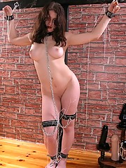A cute brunette with nice boobs on a St Andrews cross here