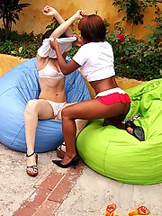 Hardcore interracial lesbian fisting by the side of a pool