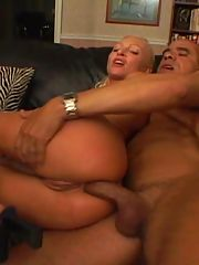 Fisting her ass while getting black dick fuck