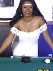 A busty ghetto girl shoots a naked game of pool