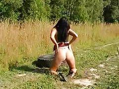 A Fantastic Slim Girl Walks in the Field